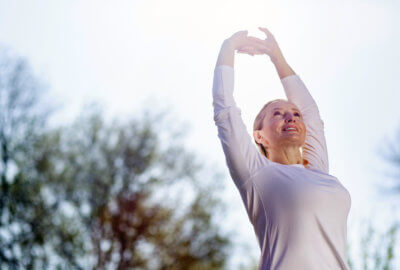 Woman performing exercise in order to achieve greater physical health